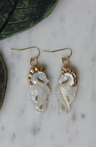 White shell seahorse carved earrings