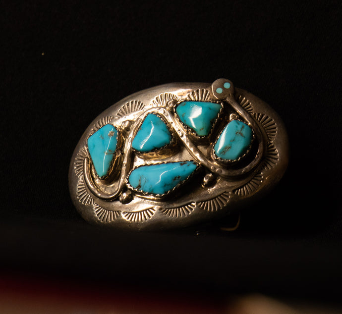Zuni belt buckle by Effie C. Turquoise and sterling silver.
