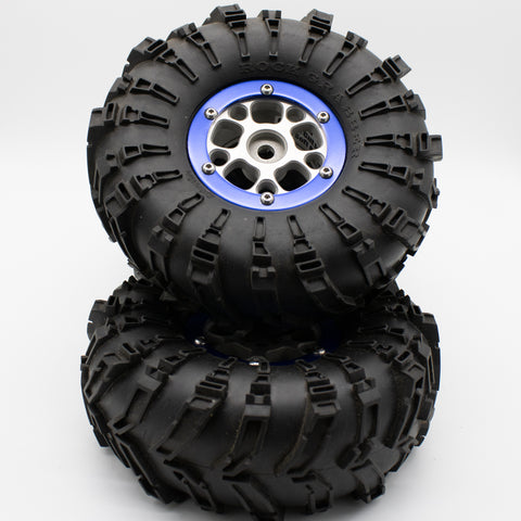 2.2 DNA wheels with blue rings,  5.5 CI foams, HPI rock grabbers. (4) - Used