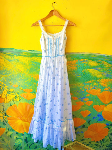 White & Blue Floral Gunne Sax Sleeveless Maxi Dress. Sold exclusively at Empress Vintage in Berkeley, CA.