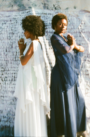 Lizzy Jeff and Moon Flower model these ethereal vintage bohemian maxi dresses from the 1970s.