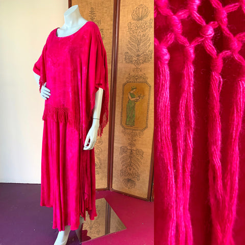 Beautiful vintage magenta dyed fringe Moroccan caftan available at Empress Vintage.