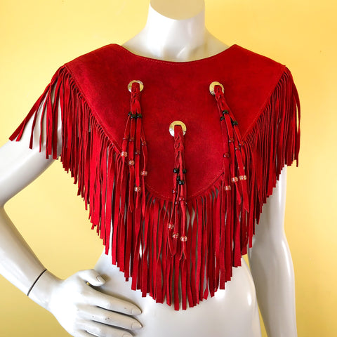 Red suede leather poncho fringe capelet with concho details!  Find more vintage clothing treasure at our shop in Berkeley, California!