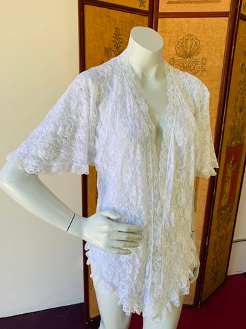 White lace vintage lingerie jacket available at Empress Vintage.  Shop our site for the latest vintage clothing arrivals.