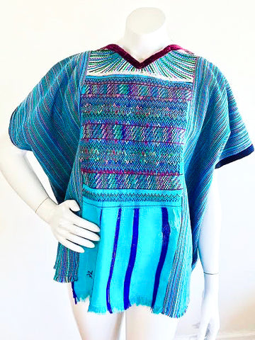 Aqua Rainbow Striped Woven Guatemalan Huipil, sold exclusively at Empress Vintage in Berkeley, CA.