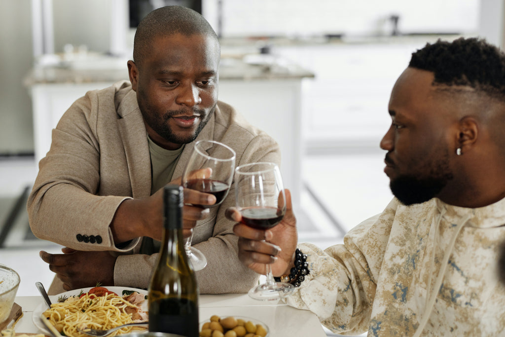 African American men drinking wine from glasses, friends party, gathering guests, how to open a bottle of wine