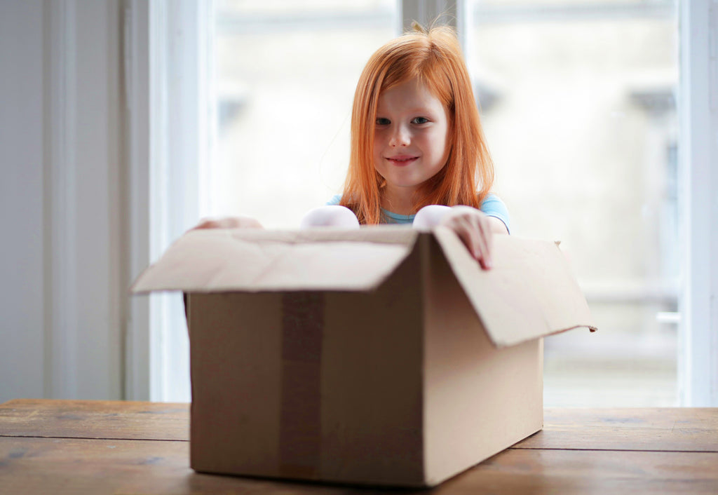 girl in a box when moving