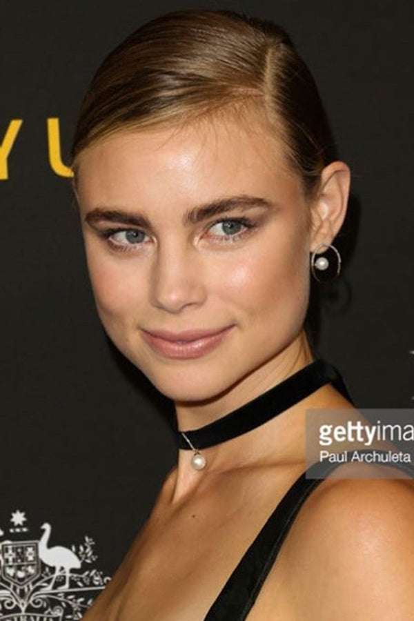 Lucy Fry , Actress  Wears our 14K Gold Half Moon Floating Pearl Hoops & Lady Mother of Pearl Velvet Choker .