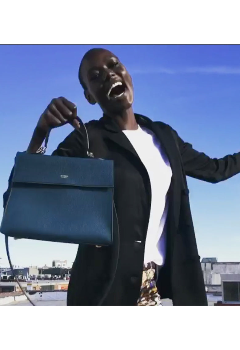 Ajak Deng , Model Wearing our Deep Emerald Elizabeth Bag .