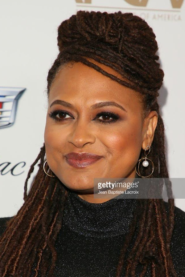 Ava DuVernay , Film Director, Producer, Screenwriter Wears our 14K Gold Half Moon Diamond & Pearl Axis Earrings .