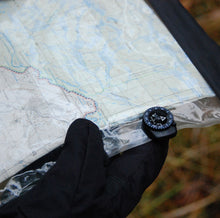 Suunto Clipper compass on a map