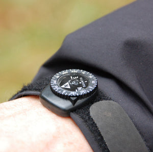 Suunto Clipper compass on the sleeve of a coat