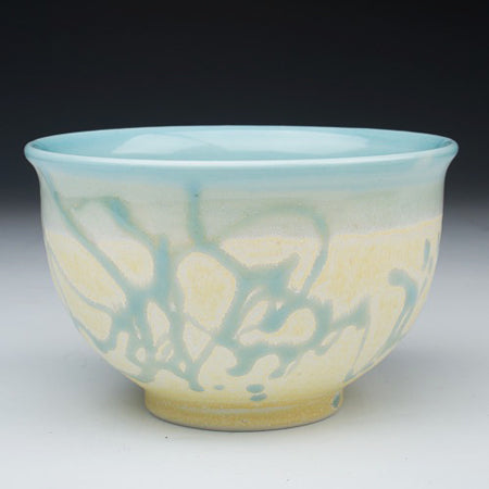 Classical and perfectly symmetrical in its form, a porcelain bowl by Chad Luberger takes on a modern look with its abstract glaze pattern.  (photo: Chad Luberger)