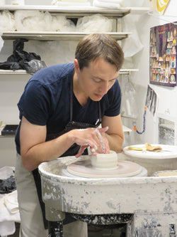 The clay centered on his wheel, Luberger begins to form a vase.  (photo: Norman Kolpas)