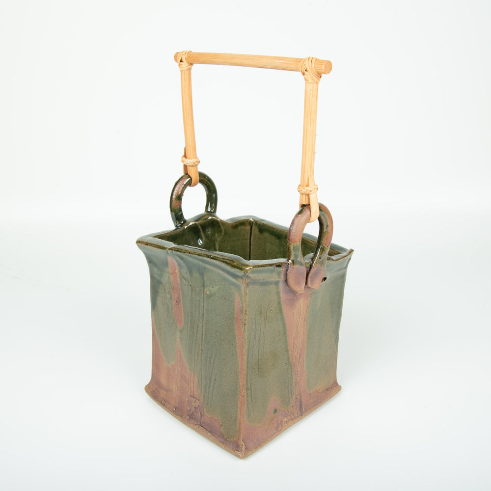 Green Handled Bucket With Red Accents