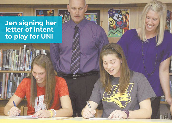 high school athlete signing letter of intent to play basketball