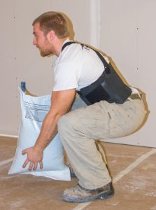 using proper lifting technique in a warehouse or construction job can prevent lower back pain
