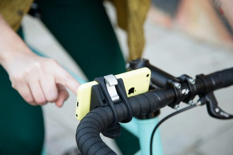 rubber phone holder that wraps around your handlebars that secures any device
