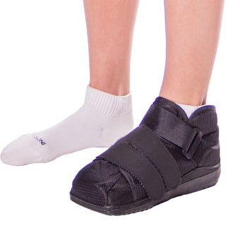 The closed toe medical walking shoe has a wide foot bed to accommodate for bandaging or a cast