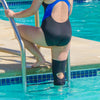 Knee support can be used in or out of water while swimming or running, for example