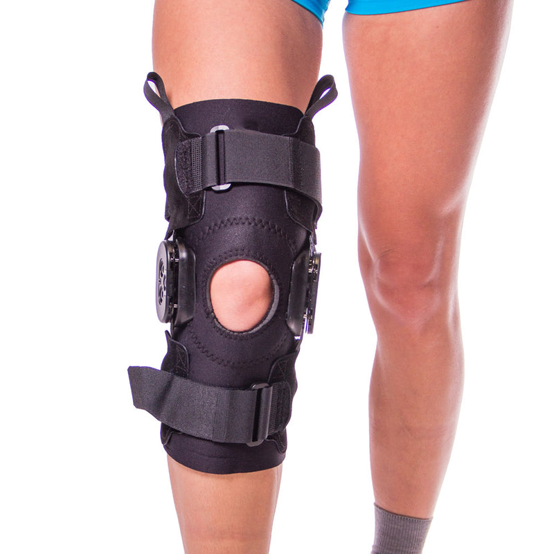 b265d8ee16 Knee brace for an overextended knee features openings at the popliteal and  patella