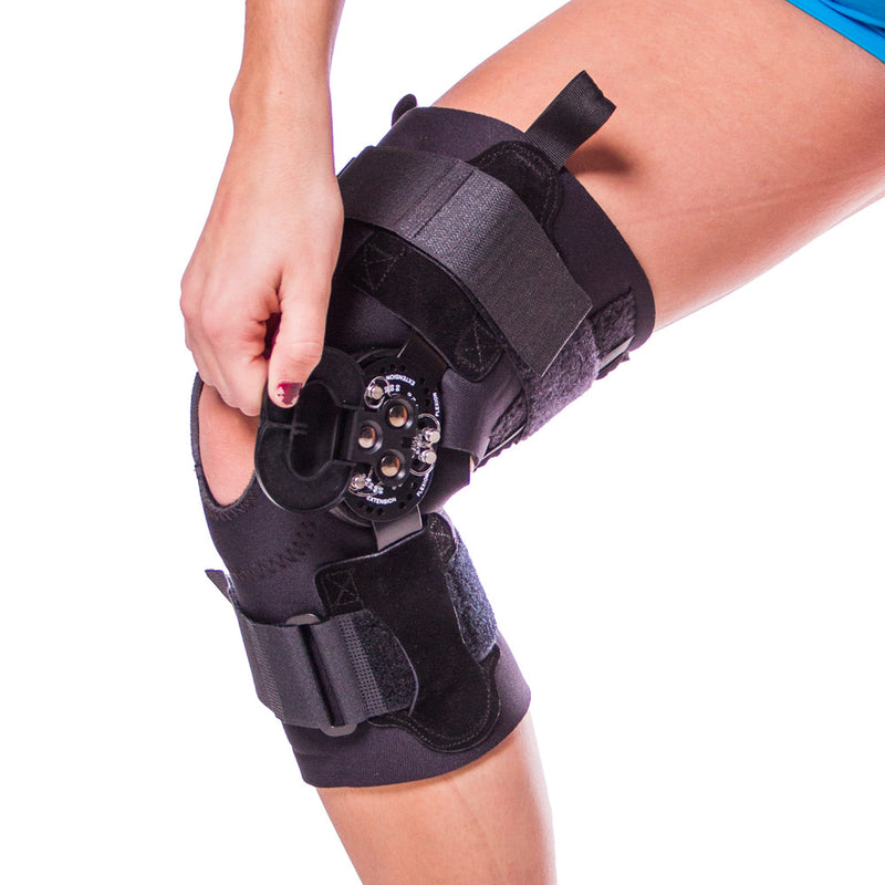 4f5b73960f Black hinged knee brace comes with a contoured condyle shell and suede  hinge cover