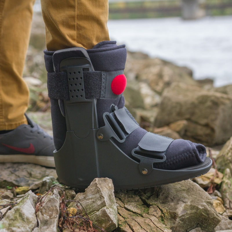 Short air walking boot has a low-profile polymer shell and innovative air cell technology