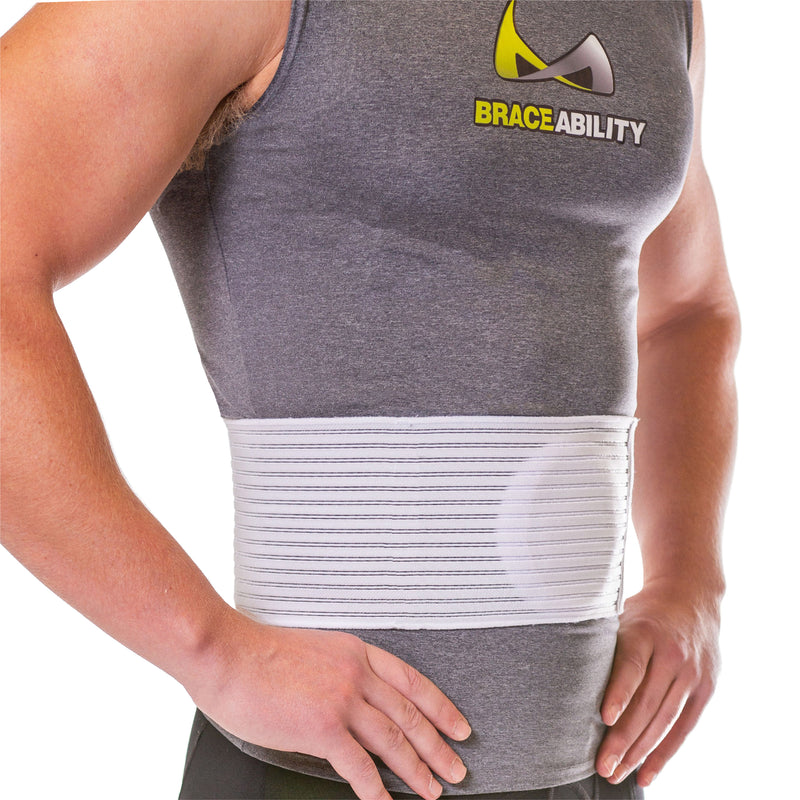 Abdominal hernia treatment belt with a raised pad