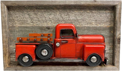 Red colored truck sign inside wooden frame