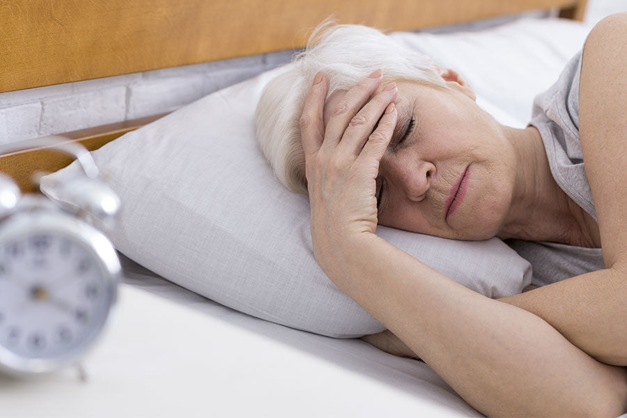 SEnior woman suffering from insomnia in bed