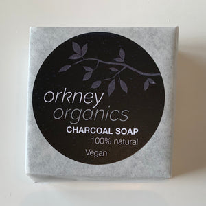 A wrapped bar of Orkney Organics, charcoal. cold pressed, vegan soap with tea tree and mint essential oil.
