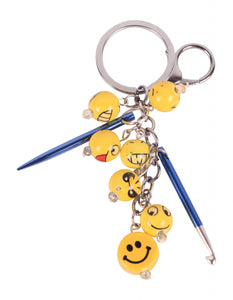 Knit pro knitting charm with 7 ceramic emoji, yellow, face charms as well as a small crocket hook for picking up dropped stitches on the go.  There is a large keyring or large lobster claw to attach your charm to a bag or zip.