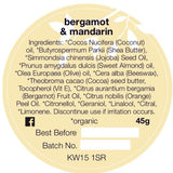 The ingredients label for Organic Gardeners hand balm, with bergamot and mandarin essential oils.