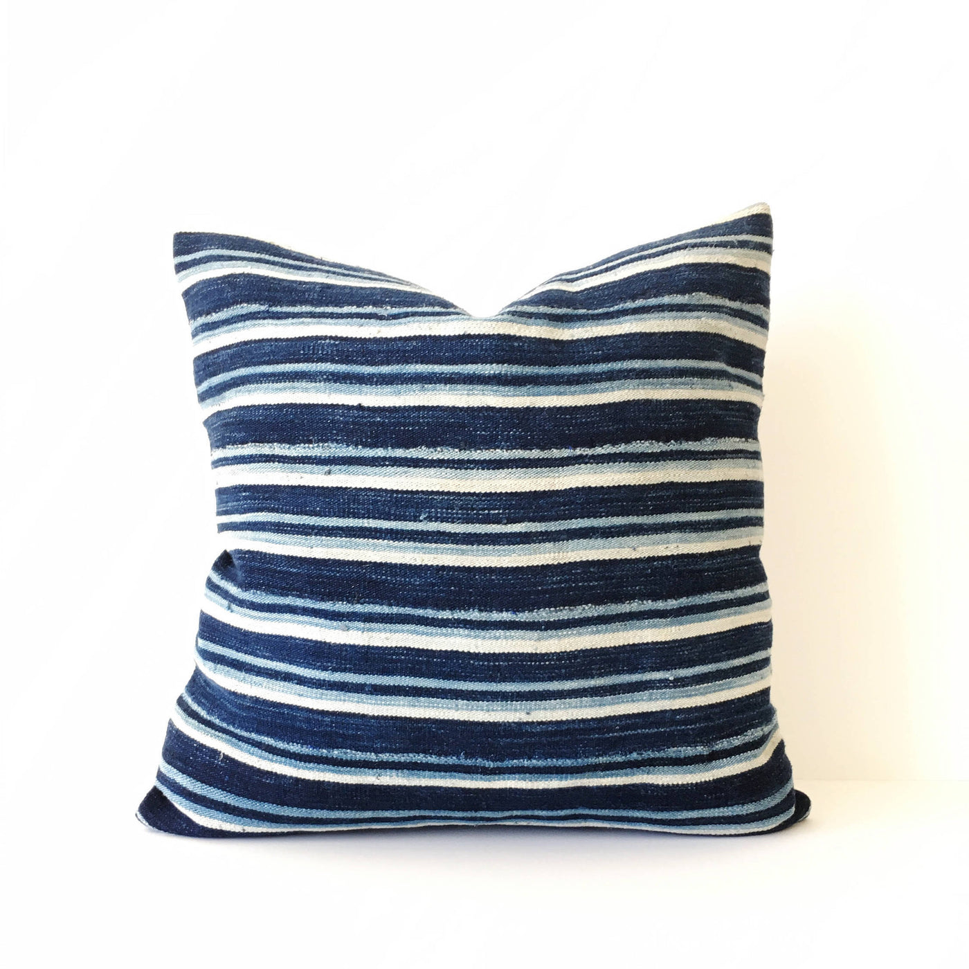 "Abeo - 18"": Striped African Throw Pillow featured by top US sustainable home decor online store, Heddle & Lamm"