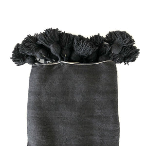 Faiza Pom Pom Throw Blanket featured by top fairtrade home goods store, Heddle & Lamm