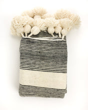 Lalla Pom Pom Throw Blanket featured by top fairtrade home goods store, Heddle & Lamm