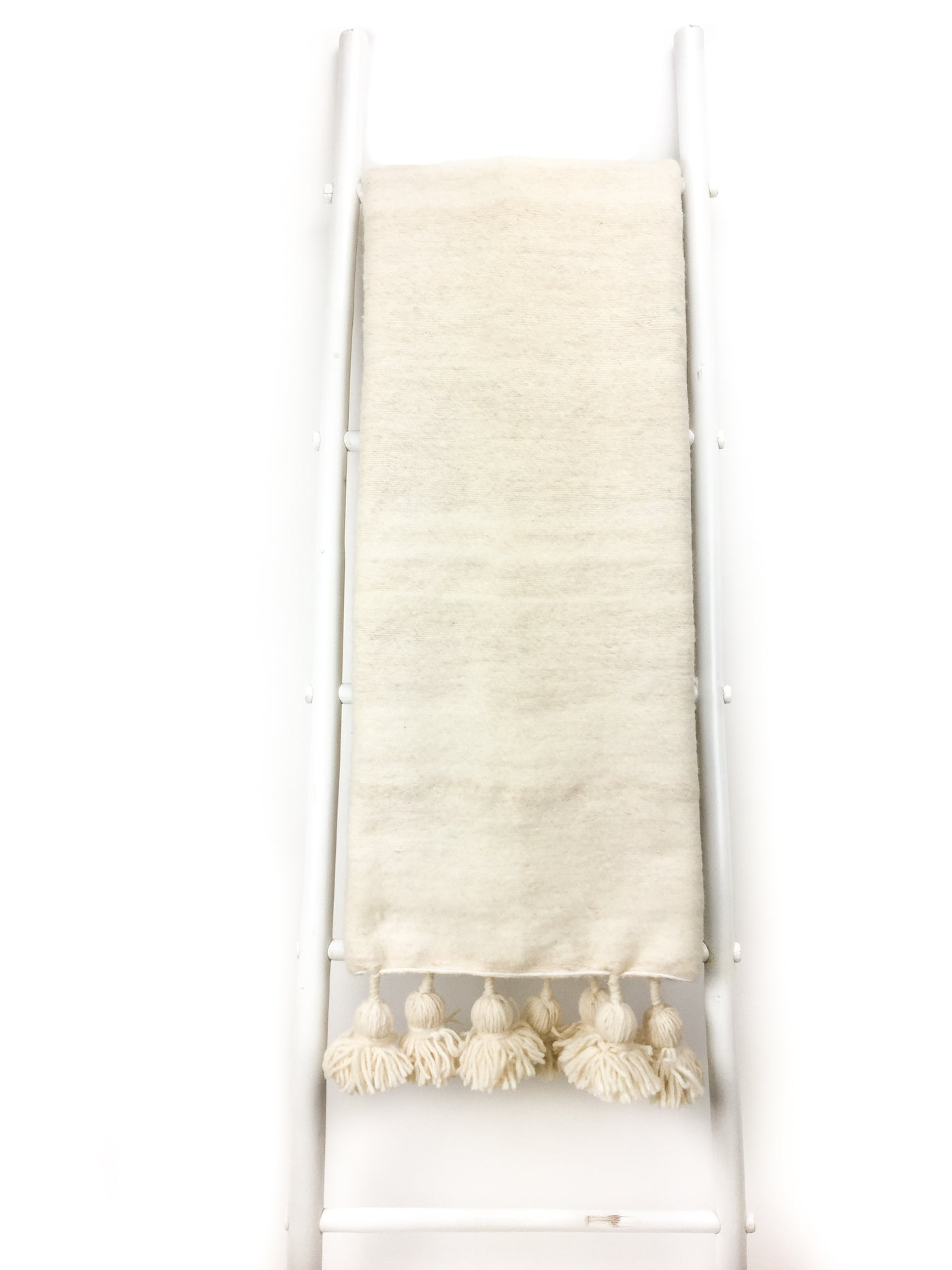 Tadla Pom Pom Throw Blanket featured by top fairtrade home goods store, Heddle & Lamm