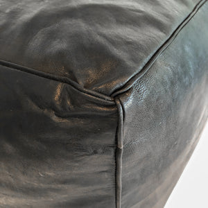 Aryn Leather Moroccan Pouf in black, featured by top sustainable home decor store, Heddle and Lamm