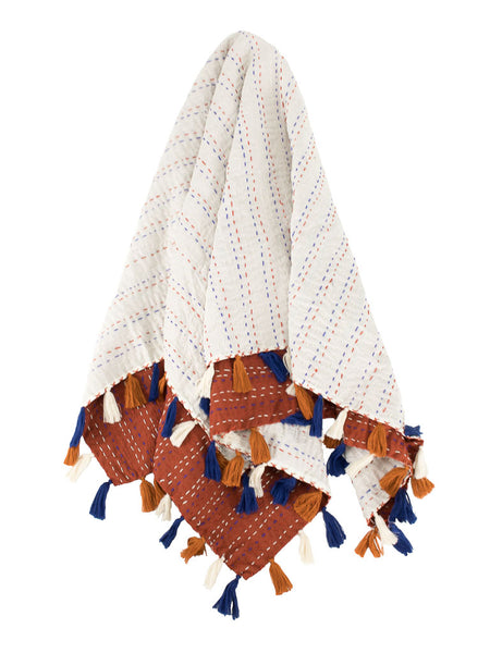 Indira Pom Pom Baby Quilt - Rust Multicolored featured by top US fairtrade home goods store, Heddle & Lamm