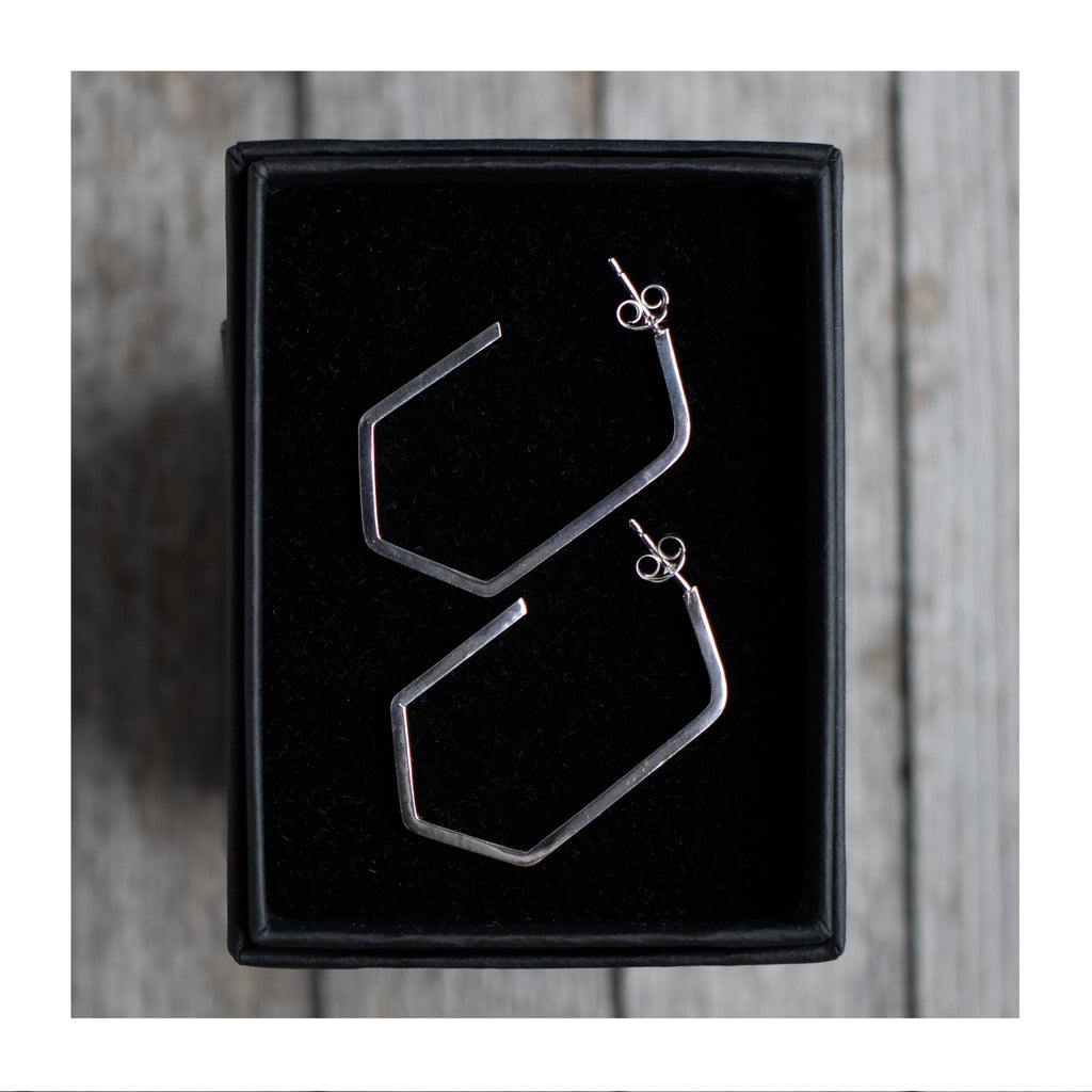 Thin hexagon hoop earrings by Aimi Cairns