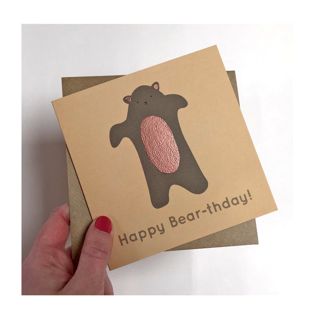 Brown card with pink foil featuring bear illustration, reads: Happy Bear-thday!