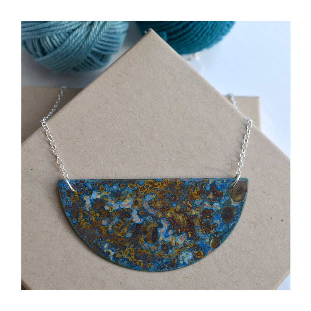 Small patinated brass crescent necklace by Stephanie Hopkins