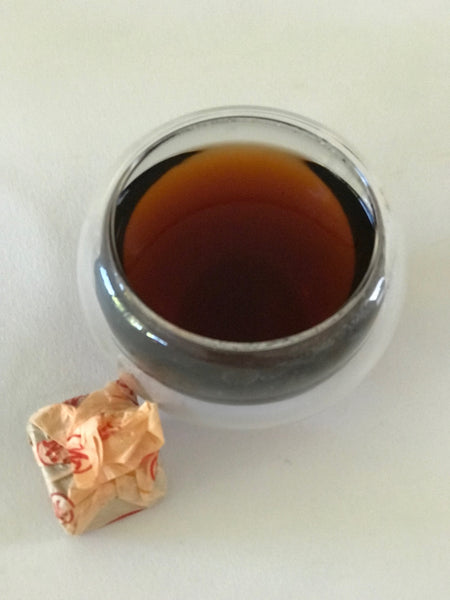PU-ERH CUBE MINI-TUOCHA is a fully fermented Pu-erh tea with  a rich & mellow earthy taste. Just like fine wine , this tea develops & naturally improves with age.