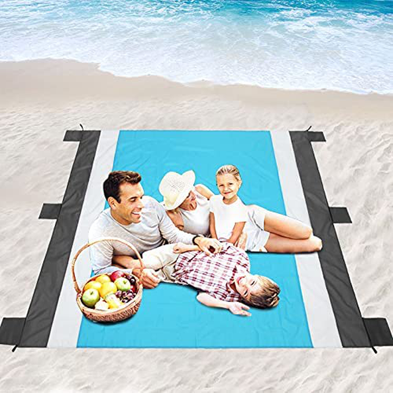 "Oileus Beach Blanket 79""x83"" Picnic Blankets Waterproof Sand Proof for 4-6 Adults Oversized Lightweight Beach Mat with 4 Stakes,6 Sand Pocket Portable Travel Camping Hiking Packable Bag Blue"