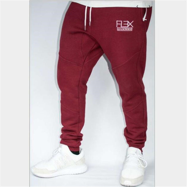 YEMEKE autumn new Men Fitness Sweatpants male gyms Bodybuilding workout cotton trousers Casual fashion Brand Pencil pants