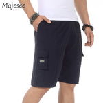 Casual Men Shorts Pockets Simple Designed Mens New Fashion Loose Solid Short Male Elastic Waist 4 Colors Summer Thin Breathable