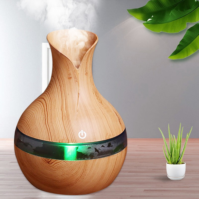 Essential Wood Grain Oil Diffuser Air Humidifier - Available in 6 Colors Was: $82.99 Now: $18.99 + Free Shipping.