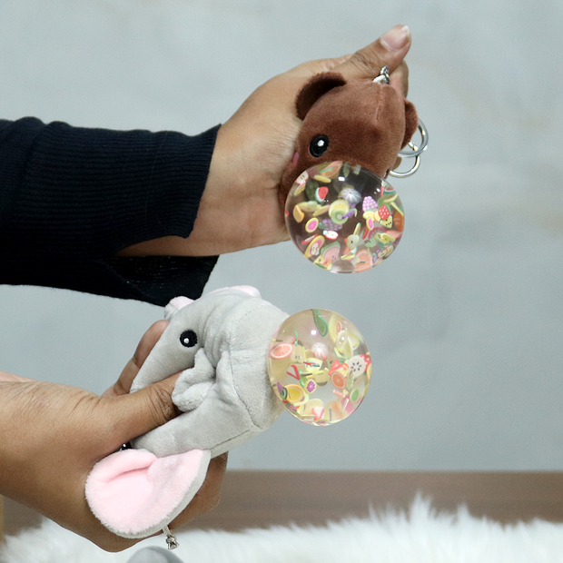 These stuffed animals soft toy keychains when pressed presents to you a cute little gumball with tiny fruit shaped figures
