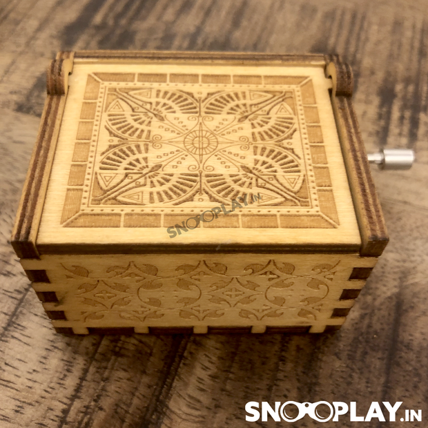 Vintage look, hand cranked musical box with happy birthday theme song.