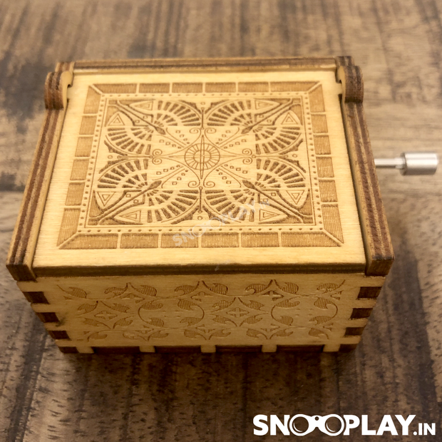 Design inspired by an old storage fashion box, this wooden hand engraved musical box is perfect for gifting.